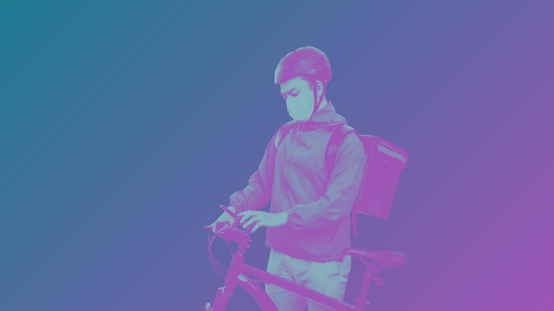 Gig worker on bike with bag