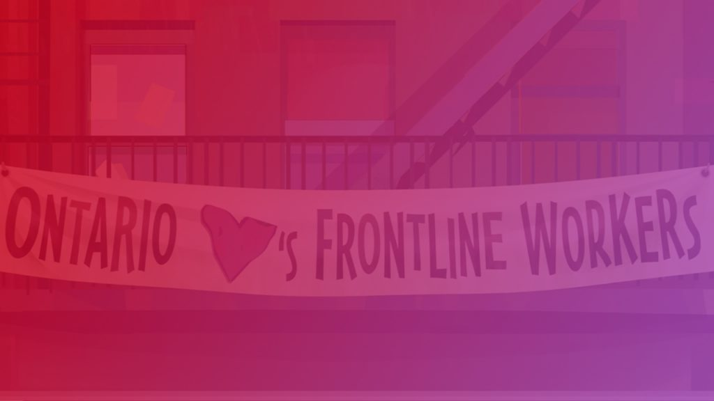 Ontario Hearts Frontline Workers banner hanging from a fire escape